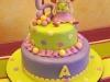 torta decorata con bambolina e biscotti